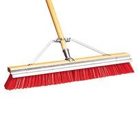 Carlisle 367395TC24 24 inch Hardwood Push Broom with Red Polypropylene Bristles, Brace, Hardwood Handle, and Scraper