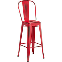 Lancaster Table & Seating Alloy Series Distressed Red Metal Indoor / Outdoor Industrial Cafe Barstool with Vertical Slat Back and Drain Hole Seat