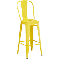 Lancaster Table & Seating Alloy Series Yellow Metal Indoor / Outdoor Industrial Cafe Barstool with Vertical Slat Back and Drain Hole Seat