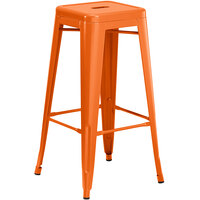 Lancaster Table & Seating Alloy Series Orange Stackable Metal Indoor / Outdoor Industrial Barstool with Drain Hole Seat