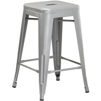 Lancaster Table & Seating Alloy Series Silver Stackable Metal Indoor / Outdoor Industrial Cafe Counter Height Stool with Drain Hole Seat