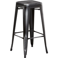 Lancaster Table & Seating Alloy Series Distressed Black Stackable Metal Indoor / Outdoor Industrial Barstool with Drain Hole Seat