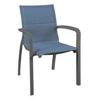 Grosfillex US900288 Sunset Volcanic Black Stacking Armchair with Madras Blue Comfort Sling Seat - 4/Pack