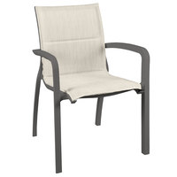 Grosfillex US012288 Sunset Volcanic Black Stacking Armchair with Beige Comfort Sling Seat - 16/Case