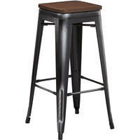 Lancaster Table & Seating Alloy Series Distressed Black Metal Indoor Industrial Cafe Bar Height Stool with Walnut Wood Seat