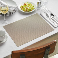 Front of the House XPM025TAV83 Metroweave 16 inch x 12 inch Tan Rush Woven Vinyl Rectangle Placemat - 12/Pack