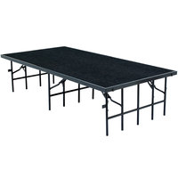National Public Seating S488C Single Height Portable Stage with Black Carpet - 48 inch x 96 inch x 8 inch