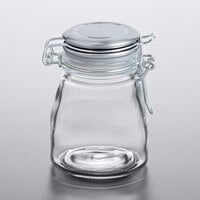 Tablecraft 10107 3 oz. Glass Condiment Jar with Stainless Steel Lid and Bail and Trigger Closure