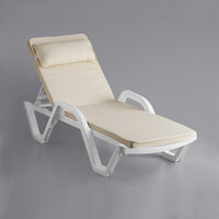 Lancaster Table & Seating White Stacking Adjustable Resin Chaise with Cream Cushion and Pillow