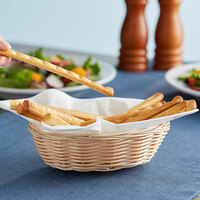 Tablecraft 1171W 7 inch x 5 inch x 2 inch Oval Natural-Colored Polypropylene / Steel Basket - 12/Pack