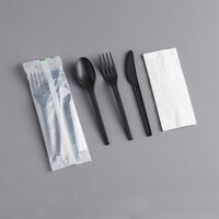 EcoChoice Wrapped Heavy Weight Compostable 6 1/2 inch Black CPLA Knife, Fork, Spoon, and Napkin - 250/Case