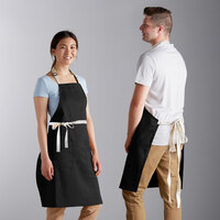 Choice Black Adjustable Bib Apron with 2 Pockets and Natural Webbing Accents - 32 inchL x 30 inchW