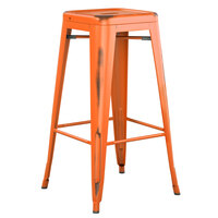Lancaster Table & Seating Alloy Series Distressed Orange Stackable Metal Indoor / Outdoor Industrial Barstool with Drain Hole Seat