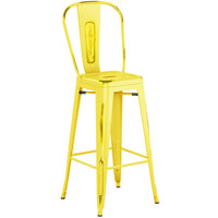 Lancaster Table & Seating Alloy Series Distressed Yellow Metal Indoor / Outdoor Industrial Cafe Barstool with Vertical Slat Back and Drain Hole Seat