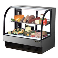 True TCGR-50-CD 50 inch Stainless Steel Curved Glass Refrigerated Deli Case - 27.4 Cu. Ft.