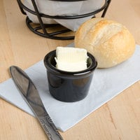 Tuxton BBX-015 DuraTux 1.5 oz. Black Smooth Ramekin - 48/Case