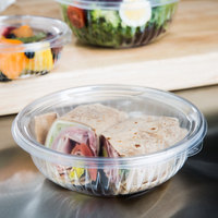 Dart C24HBF PresentaBowls 24 oz. Clear Hinged Plastic Bowl with Flat Lid - 150/Case