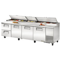 True TPP-119D-2 119 inch Refrigerated Pizza Prep Table with Three Doors and Two Drawers