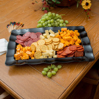Carlisle 794403 19 1/2 inch x 13 inch Black Rectangular Small Scalloped Tray - 4/Case