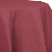 Creative Converting 923122 82 inch Burgundy OctyRound Tissue / Poly Table Cover - 12/Case