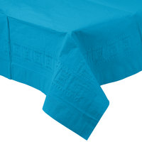 Creative Converting 713131 54 inch x 108 inch Turquoise Blue Tissue / Poly Table Cover - 6/Case