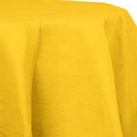 Creative Converting 923269 82 inch School Bus Yellow OctyRound Tissue / Poly Table Cover - 12/Case