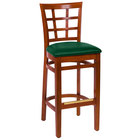 BFM Seating LWB629CHGNV Pennington Cherry Beechwood Bar Height Chair with Window Wooden Back and 2 inch Green Vinyl Seat
