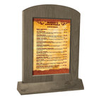 Menu Solutions WTARCH-B-2S 5 inch x 7 inch Weathered Walnut Arched Wood Menu Tent with Angled Base
