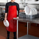 """San Jamar EZKAPR EZ-Kleen Red Cleaning / Dishwashing Apron - 25 1/2"""" x 36"""""""