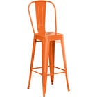 Lancaster Table & Seating Alloy Series Orange Metal Indoor / Outdoor Industrial Cafe Barstool with Vertical Slat Back and Drain Hole Seat
