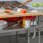 Regency 30 inch x 24 inch 16-Gauge Stainless Steel Equipment Stand with Galvanized Undershelf, 10 inch Plate Shelf, and 10 inch Wooden Adjustable Cutting Board