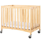 Foundations 2731040 Travel Sleeper 24 inch x 38 inch Natural Compact Slatted Wood Folding Crib with Oversized Casters and 2 inch InfaPure Mattress