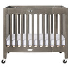 Foundations 2131480 Boutique 24 inch x 38 inch Dapper Gray Compact Slatted Wood Folding Crib with Oversized Casters and 3 inch InfaPure Mattress