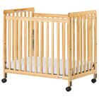 Foundations 1631040 SafetyCraft 24 inch x 38 inch Natural Compact Slatted Wood Crib with Fixed Sides, SafeSupport Adjustable Mattress Board, and 3 inch InfaPure Mattress