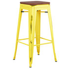 Lancaster Table & Seating Alloy Series Distressed Yellow Stackable Metal Indoor Industrial Barstool with Walnut Wood Seat