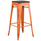 Lancaster Table & Seating Alloy Series Distressed Orange Stackable Metal Indoor Industrial Barstool with Black Wood Seat