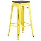 Lancaster Table & Seating Alloy Series Distressed Yellow Stackable Metal Indoor Industrial Barstool with Black Wood Seat
