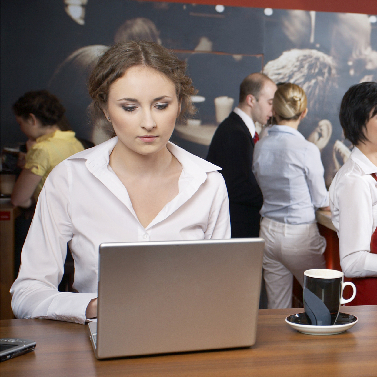 woman working on a computer in a restaurant