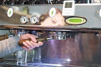 removing a portafilter from an espresso machine