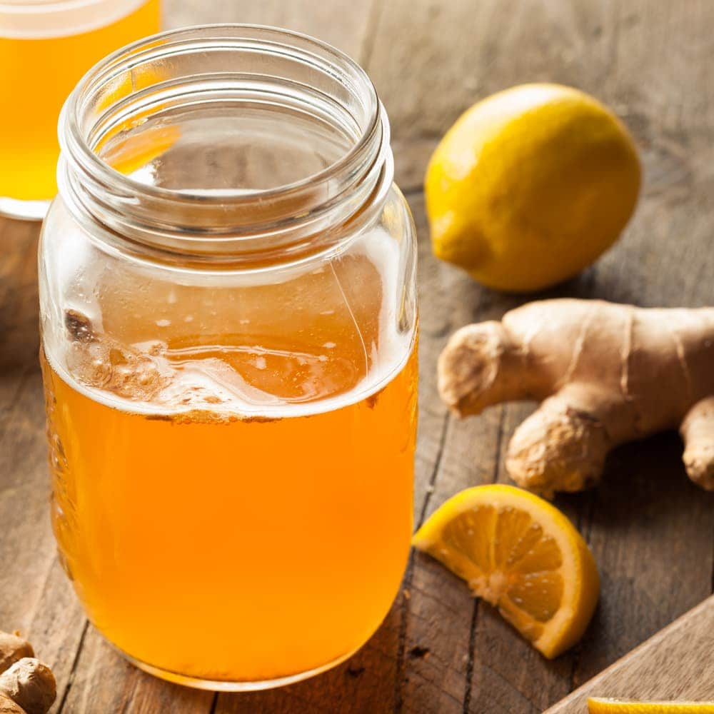 ginger and lemon kombucha in a mason jar