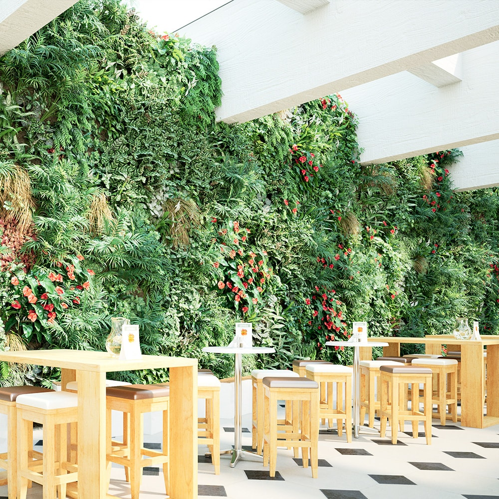 cafe with a large wall covered in plants