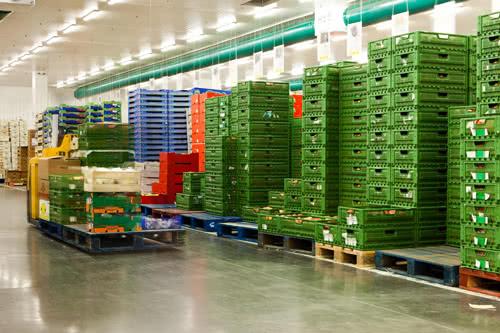 shipping warehouse with shipping crates and forklift