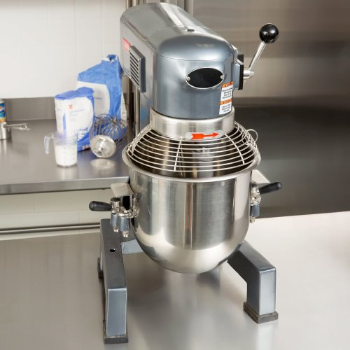 Small commercial mixer on a stainless steel table