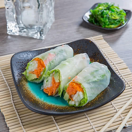 spring rolls on brown and turquoise stoneware square plate
