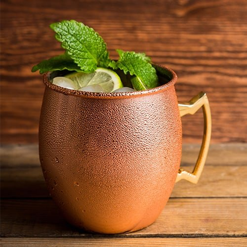 Lined copper mug holding a moscow mule inside