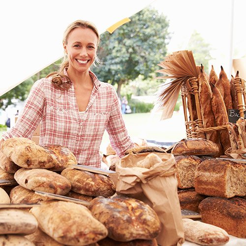 home baker selling bread at farmers market