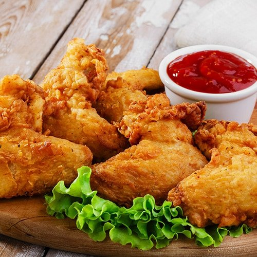fried chicken on wooding cutting board with dipping sauce