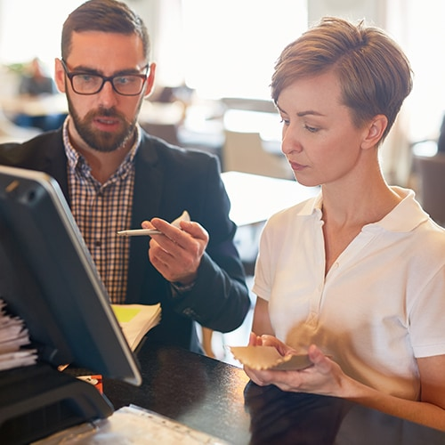 restaurant owners looking at a computer