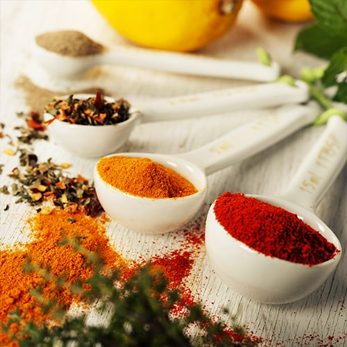 Herbs and spices in measuring spoons