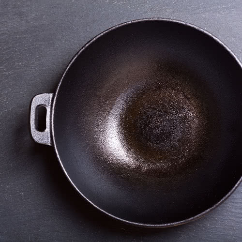 Cast iron wok with handles